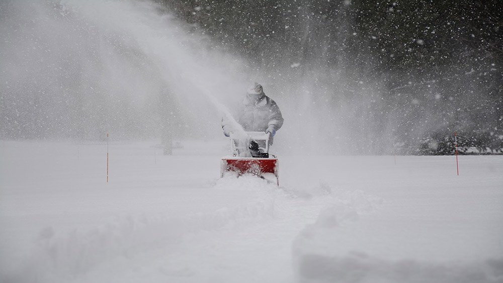 Coastal Pacific landscaping Service including using a snow blower to clear sidewalks