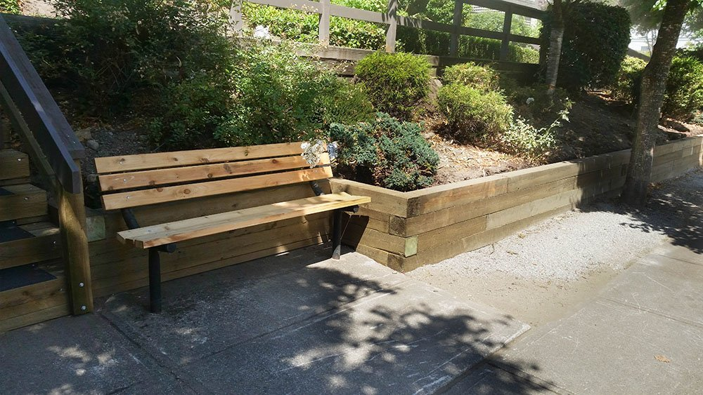 Landscape Service including Landscape Installation of wood retaining wall, wood stairs and park bench